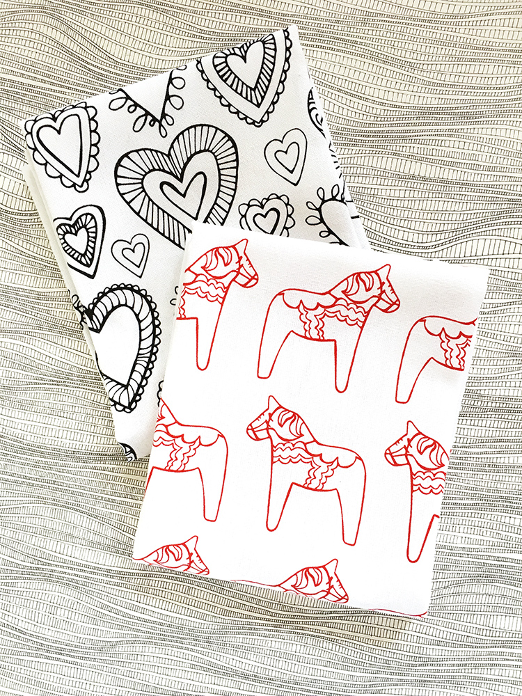 My newest hand printed tea towel designs feature a dala horse and hearts. Click through to purchase!