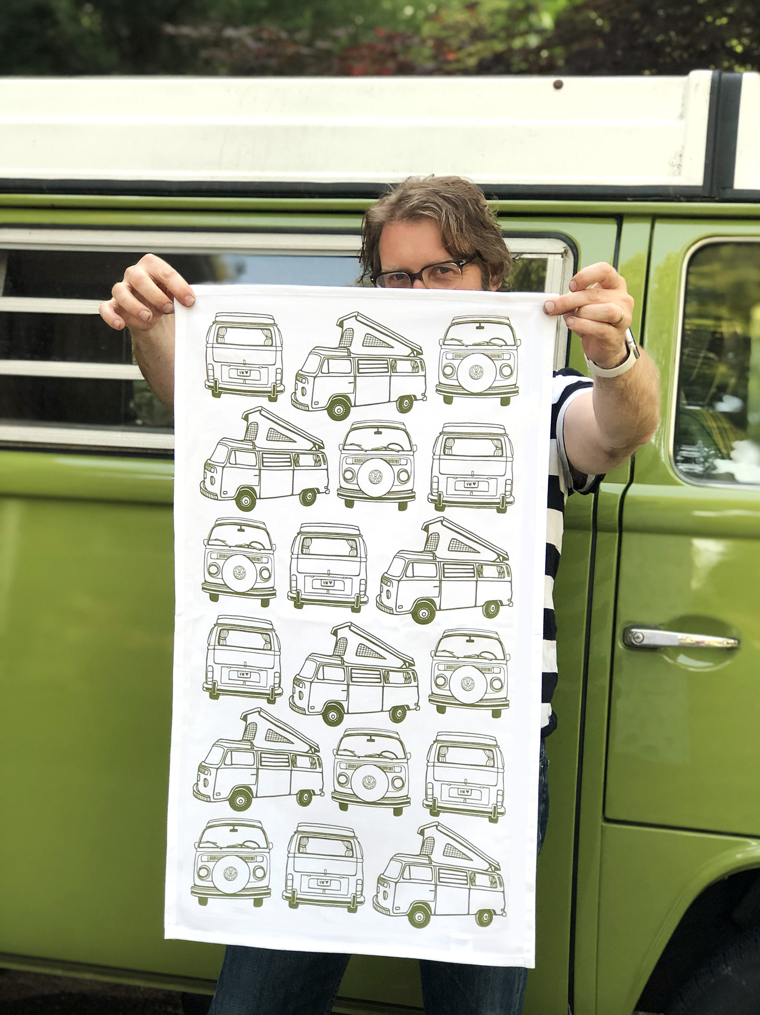My husband modeling my new VW Bus tea towel in front of the bus that inspired it.