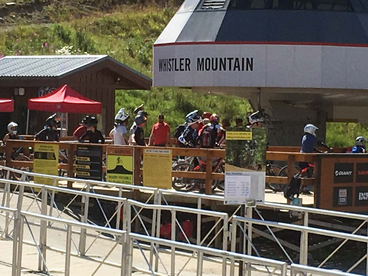 Catching the Whistler chair lift for downhill mountain biking with Arbutus Routes.