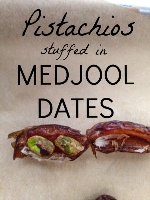Stuffing dates with salted pistachios for Easy Chocolate Pistachio Date Caramels.
