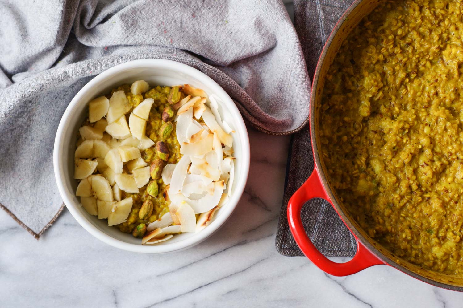 Pot of gold: Golden banana Oatmeal topped with pistachios, bananas, and toasted coconut.