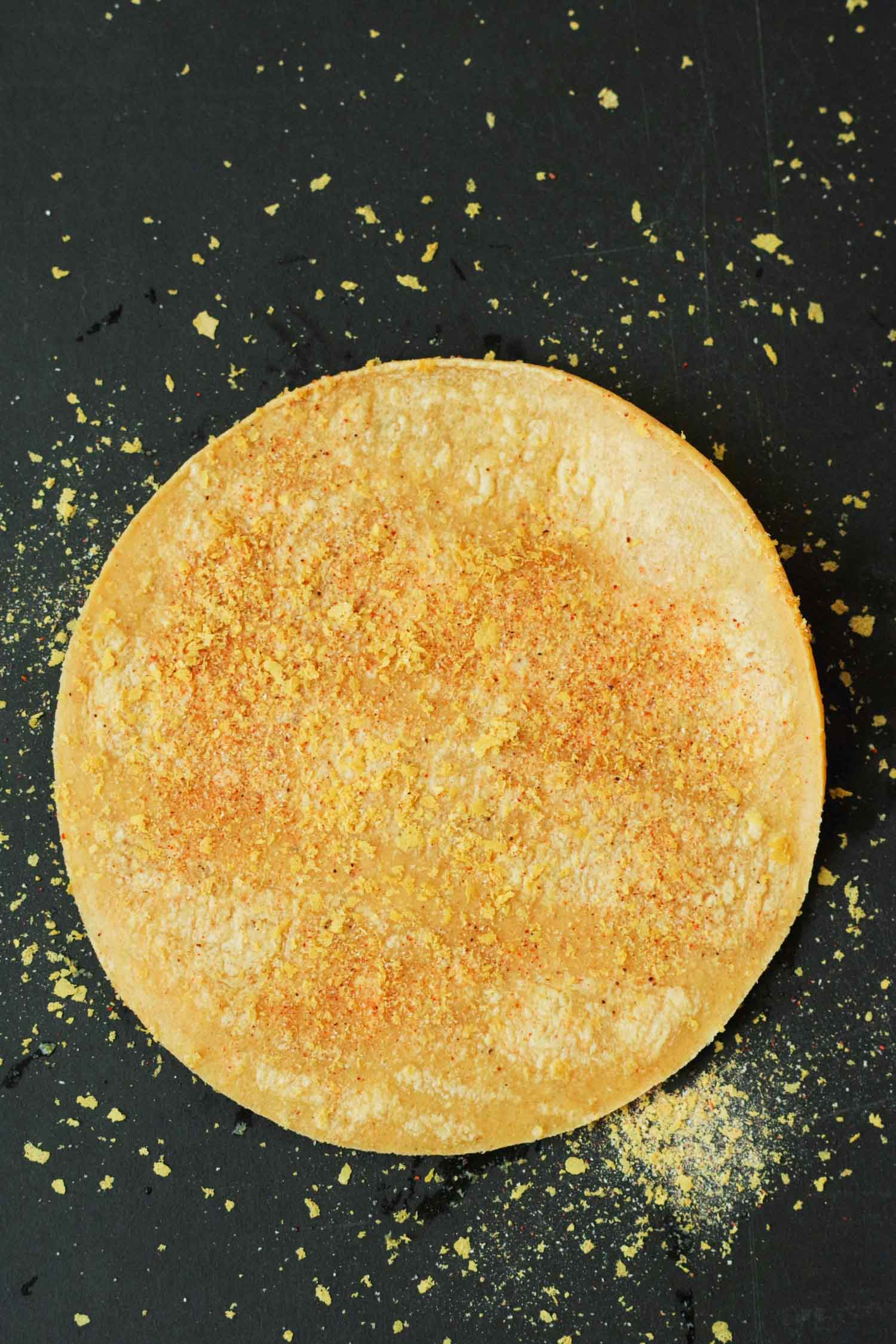 Spiced tortilla ready to cut into triangles for baking chips. By Beautiful Ingredient.