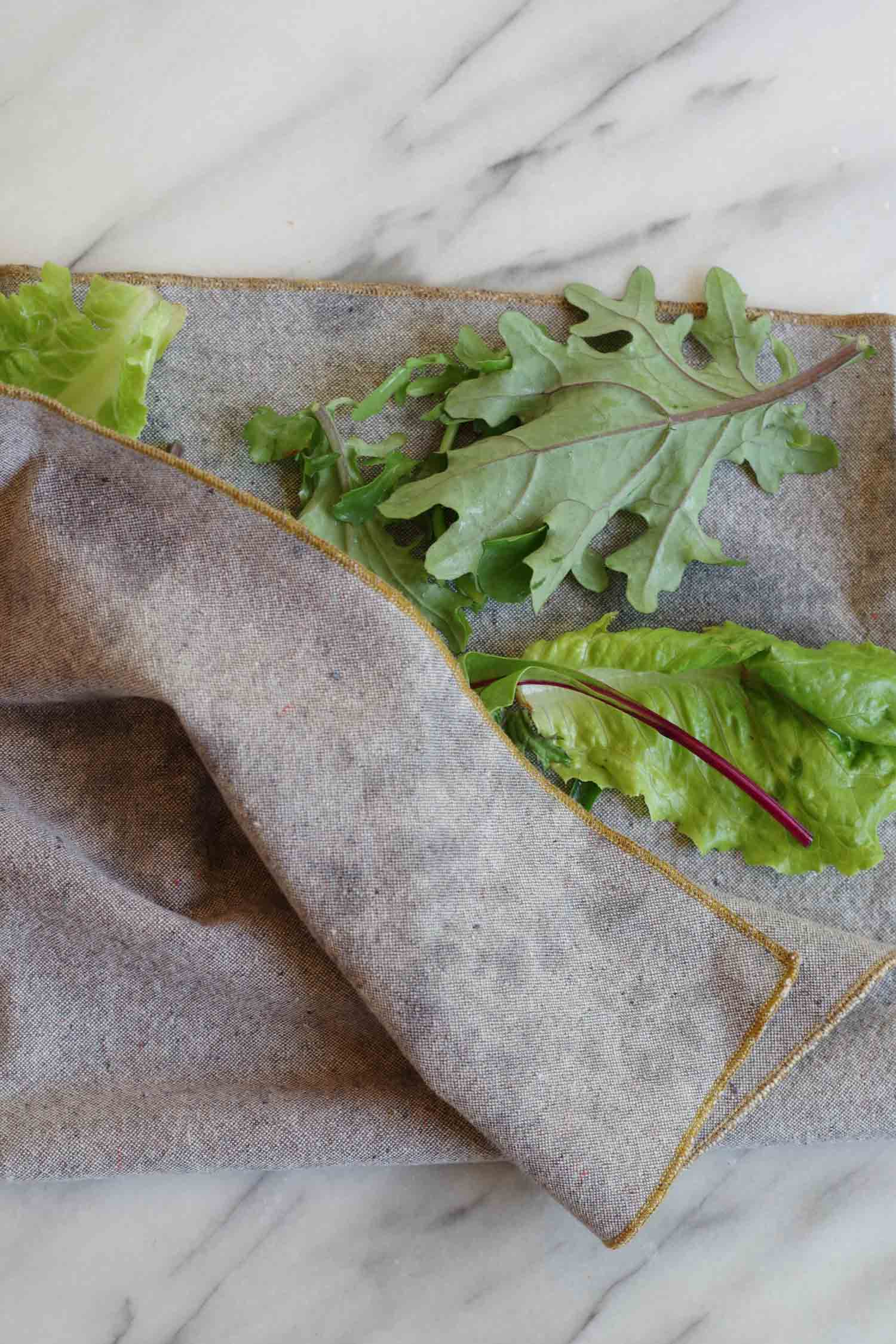 Patting greens dry with an organic cotton/hemp Heathered Napkin from the shop, by Beautiful Ingredient