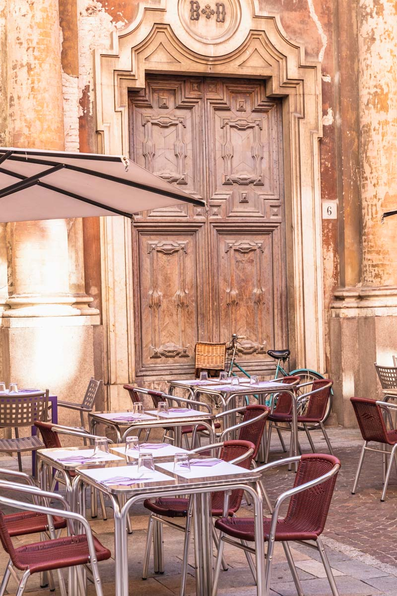Outdoor seating at a cafe in Parma. Photo by Kari | Beautiful Ingredient.