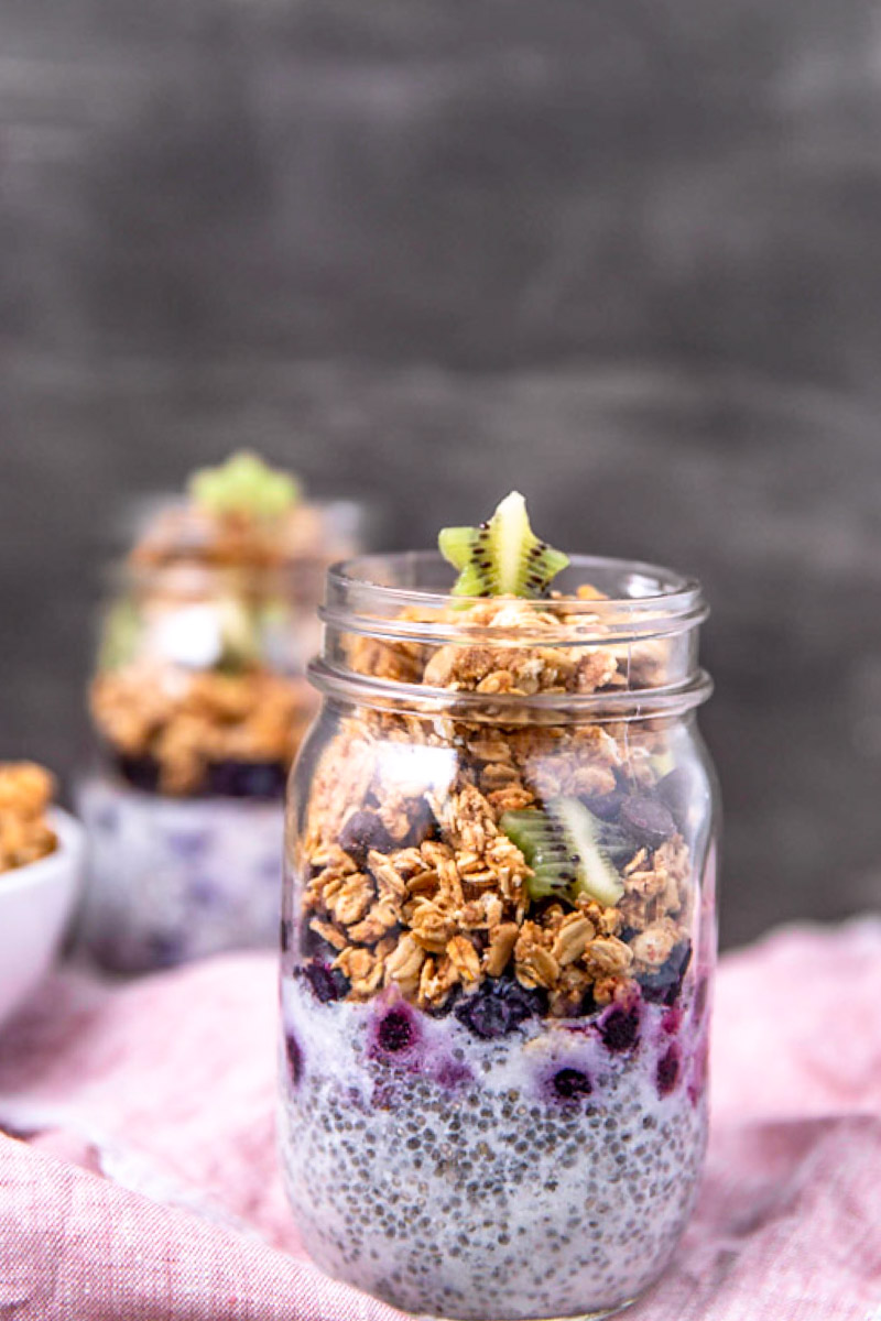 Make-Ahead Chia Pudding Parfaits with Peanut Butter Chocolate Chip Granola from  The College Vegan Cookbook  by Heather Nicholds. Photos by Kari of Beautiful Ingredient. #chiapudding #veganbreakfast #parfait #cookbook #peanutbutter #chocolatechip #granola #breakfast #make-ahead #mealplanning #college #collegelife #collegevegan #studentlife #vegancollegestudent #veganrecipes #easyveganrecipe #easyveganbreakfast #dorm #dormlife