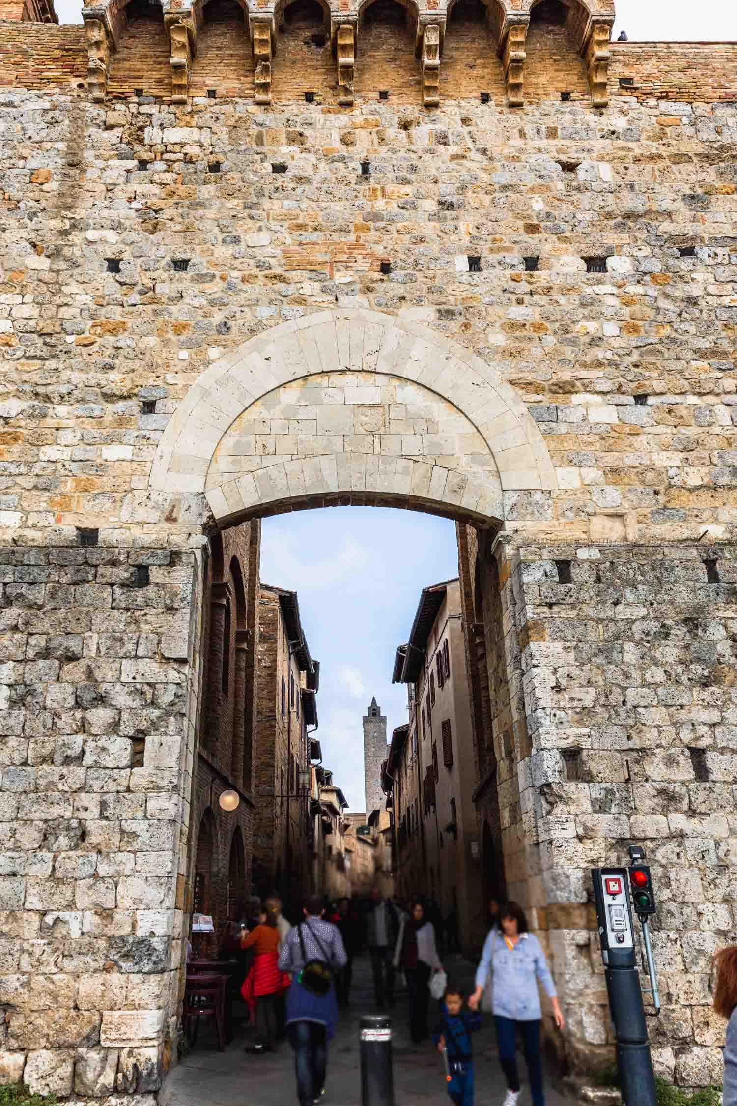 The entrance to San Gimignano, Italy. #tuscany #travel #italy #italianfarmhouse #olivegroves #towers #vineyards #italyinautumn #veganrestaurant #vegantravel #italytravel #veganitaly #vegantuscany #veganhotel #ecotourism #organichotel #veganhotel #veganretreat #veganbedandbreakfast #sangimignano