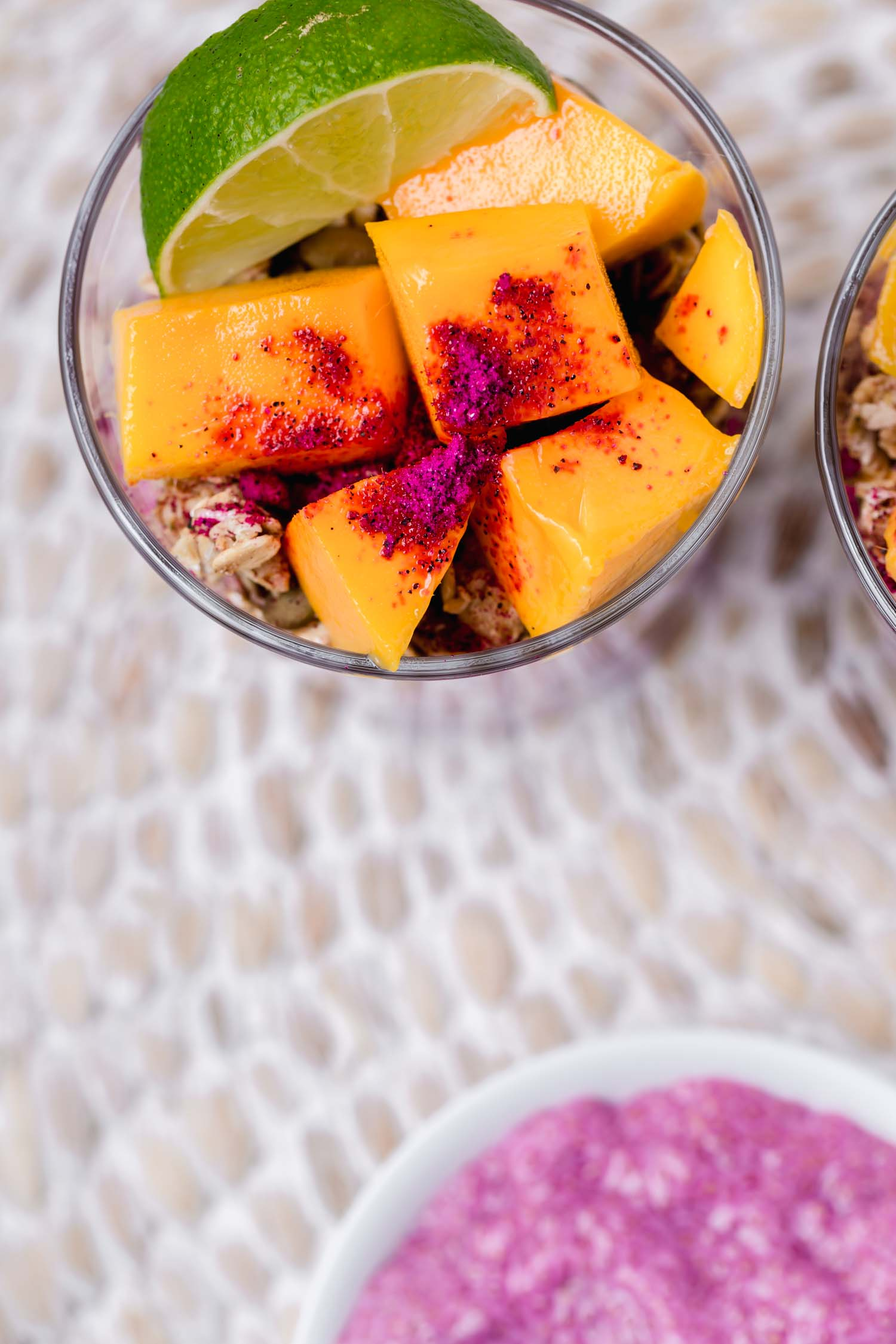 Tropical Dragon Fruit Chia Pudding Breakfast Bowls or Parfaits, so easy to make, colorful, and a real summer treat! #chiapudding #chiapuddingparfait #breakfastbowl #breakfast #vegan #veganbreakfast #veganrecipe #tropicalrecipe #tropicalveganrecipe #summerrecipe #dragonfruit #pitaya #tropicalbowl