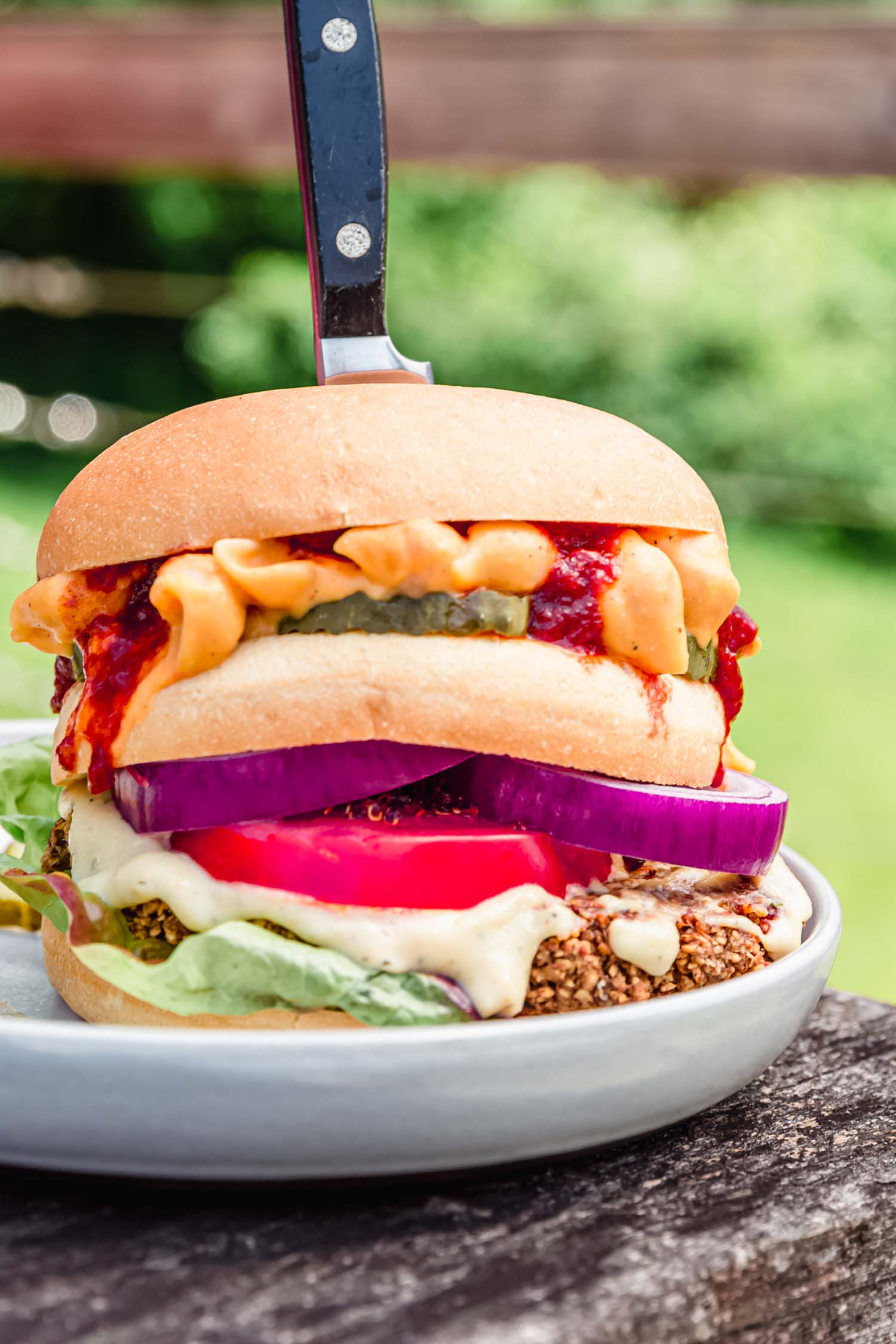 All-American Burger from Epic Vegan by Dustin Harder. Image by Kari at Beautiful Ingredient. #veganburger #fourthofjulyrecipe #veganrecipes #recipe #epicvegan #summerrecipe #veggieburgerrecipe #veggieburger