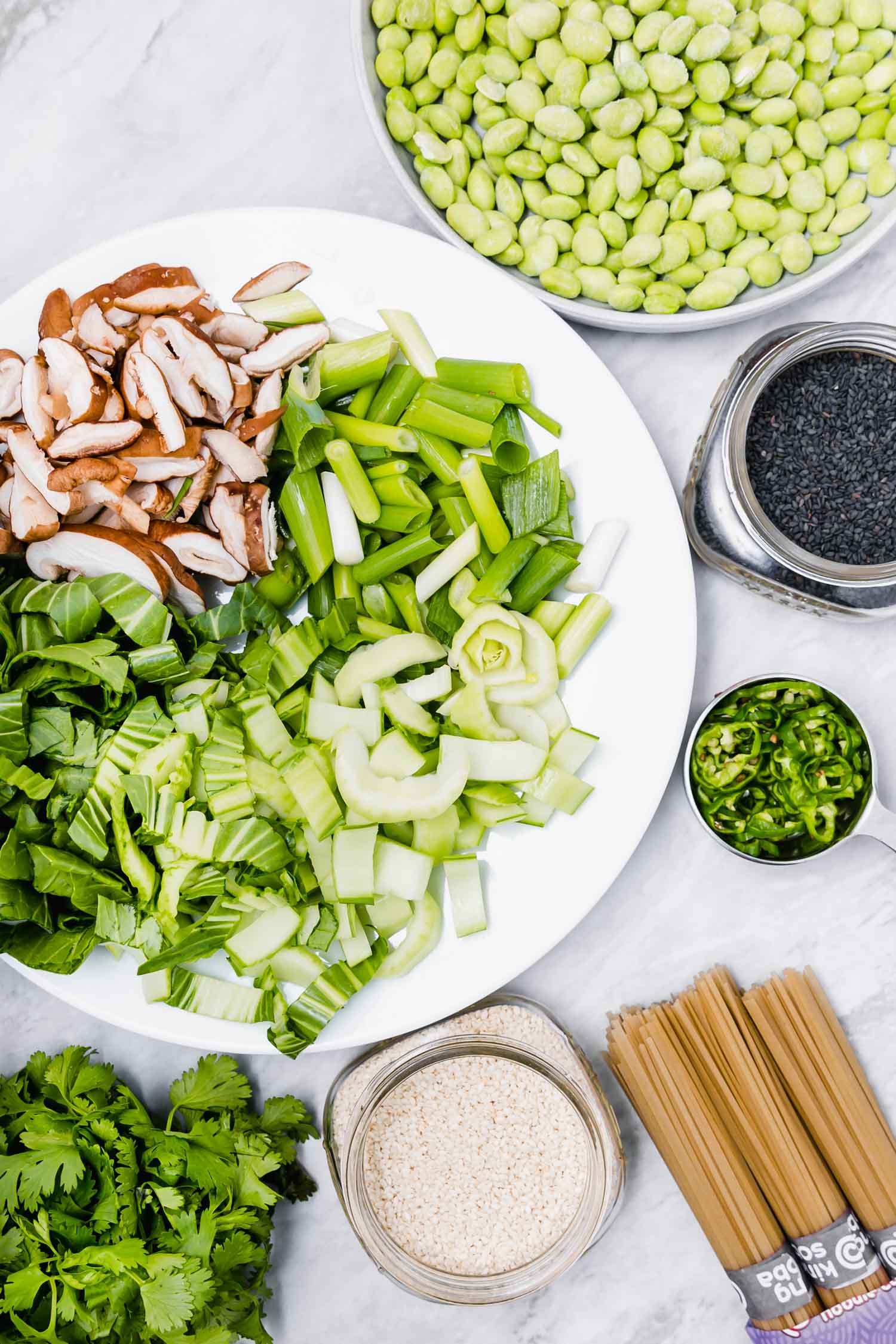 mise en place. Edamame and Bok Choy Sauté with Rice Noodles and Miso Lime Sauce    is plant-based, quick (ready within 30 minutes from chopping to plating), easy, gluten-free, oil-free, nut-free, veggie-packed (with three servings of veg per person - including one cruciferous), satisfying (with a serving of beans per person), and great all year round, especially during the fall/winter seasons. #vegandinner #ricenoodles #misosauce #wfpb #dinner #plantbased #edamame #bokchoy