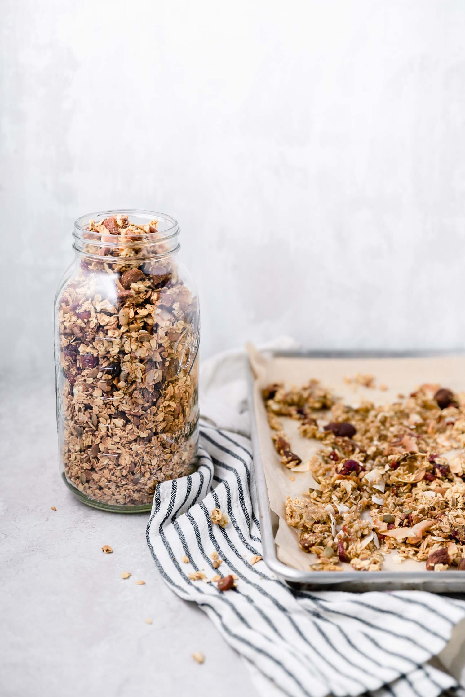 Easy Orange Pecan Power Granola is an easy recipe to make and loaded with goodies. #vegangranola #orangepecan #pecangranola #homemadegranola #recipe #veganrecipe #breakfastrecipe #plantbased