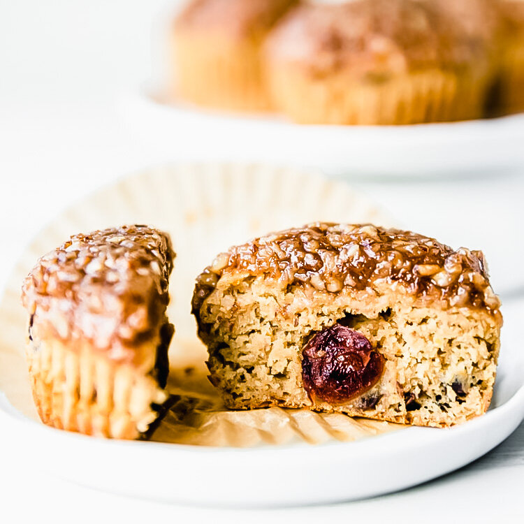 Easy Gluten-free Vegan Cranberry Orange Muffins with Maple Pecan Topping. Recipe & photo by Kari | Beautiful Ingredient. #glutenfree #vegan #oat #muffins #breakfast #orange #cranberry #maple #bourbon #pecan
