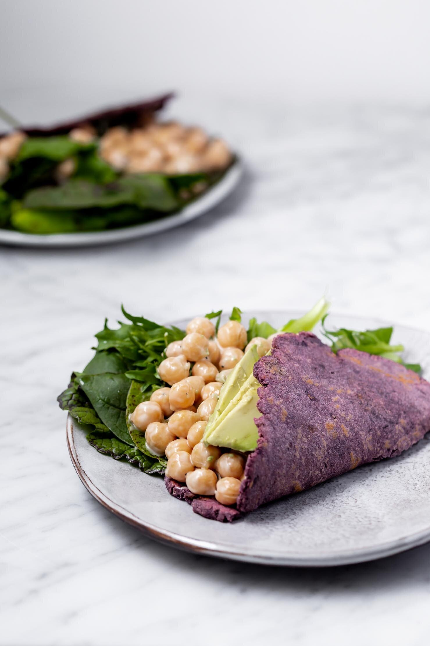 These Easy Potato Flatbreads only require two pantry staple ingredients and make great wraps, tortillas, naan, and pizza crust. By Kari of Beautiful Ingredient. #flatbread #homemade #potato #twoingredientrecipe #easyrecipe #vegan #glutenfree #nutfree #yeastfree #tortilla #purple #pizzacrust #naan #quickbread