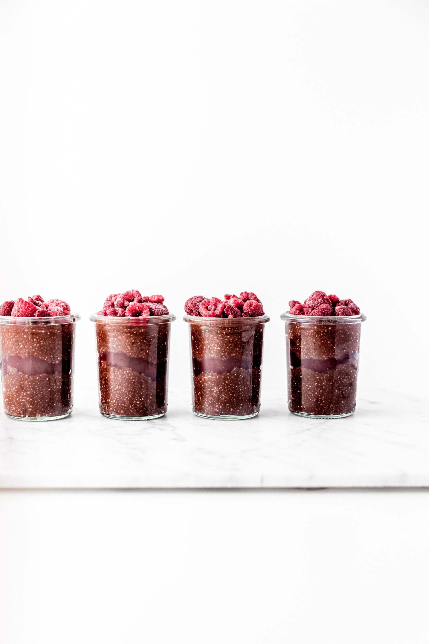 This Chocolate Raspberry Chia Pudding is vegan, gluten-free, and ready to eat in 10 minutes. #plantbased #veganrecipe #vegan #breakfast #chiapudding #raspberry #chocolate #refinedsugarfree #quickandeasyrecipe #easybreakfast #quickbreakfast #vegandessert #glutenfree #chia