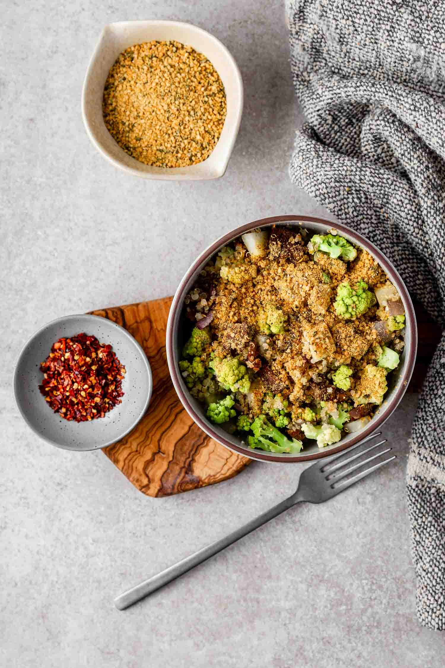 Smoky Hemp Heart Seasoning with nutritional yeast, which is optional. So good on just about anything, like this quinoa with sautéed romanesco and kohlrabi with tempeh and quinoa. #smoky #hempheart #hempseed #seasoning #topping #smokytopping #smokyseasoning #vegan #plantbased #veganrecipe #glutenfreevegan #flavoring #veganflavoring