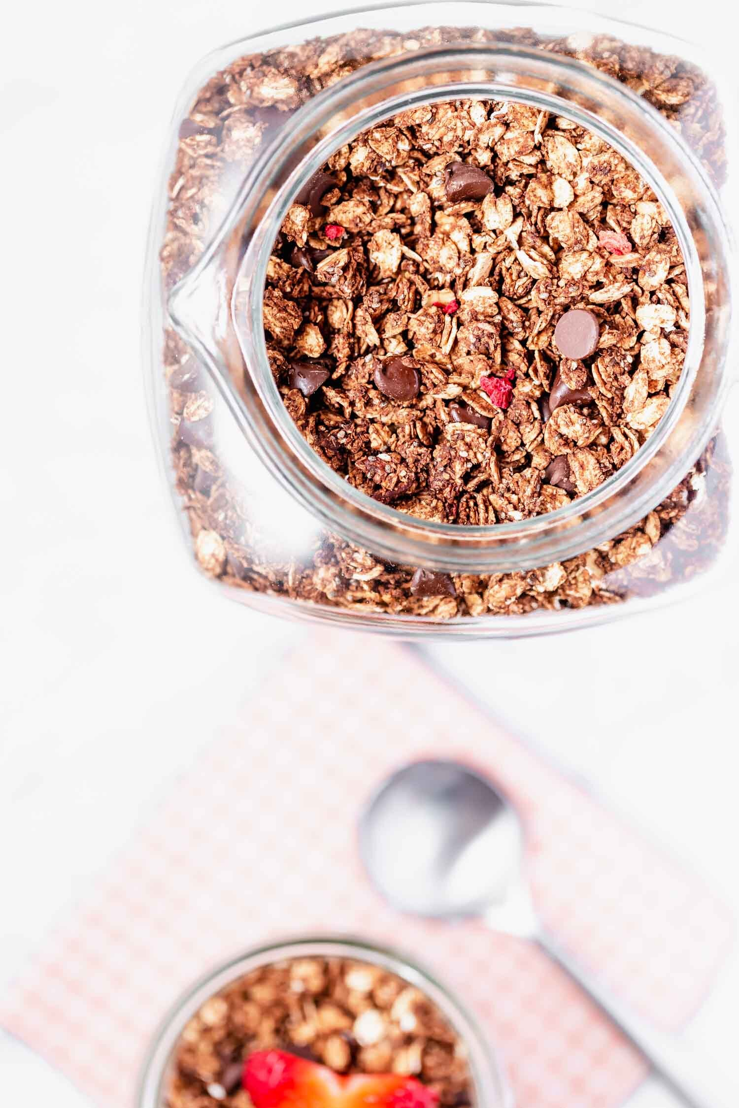 Chocolate and freeze-dried berries are the perfect combo in this crispy granola, inspired by store-bought granola. Vegan, gluten-free, oil-free, sugar-free (optional), easy, with minimal prep time, yet makes a big batch.  #granola #granolarecipe #vegangranola #oilfreevegan #sugarfree #vegangranolarecipe #veganbreakfast #quickbreakfast #quicksnack #vegansnack #breakfastideas #breakfastideashealthy #breakfastrecipes #glutenfreerecipes