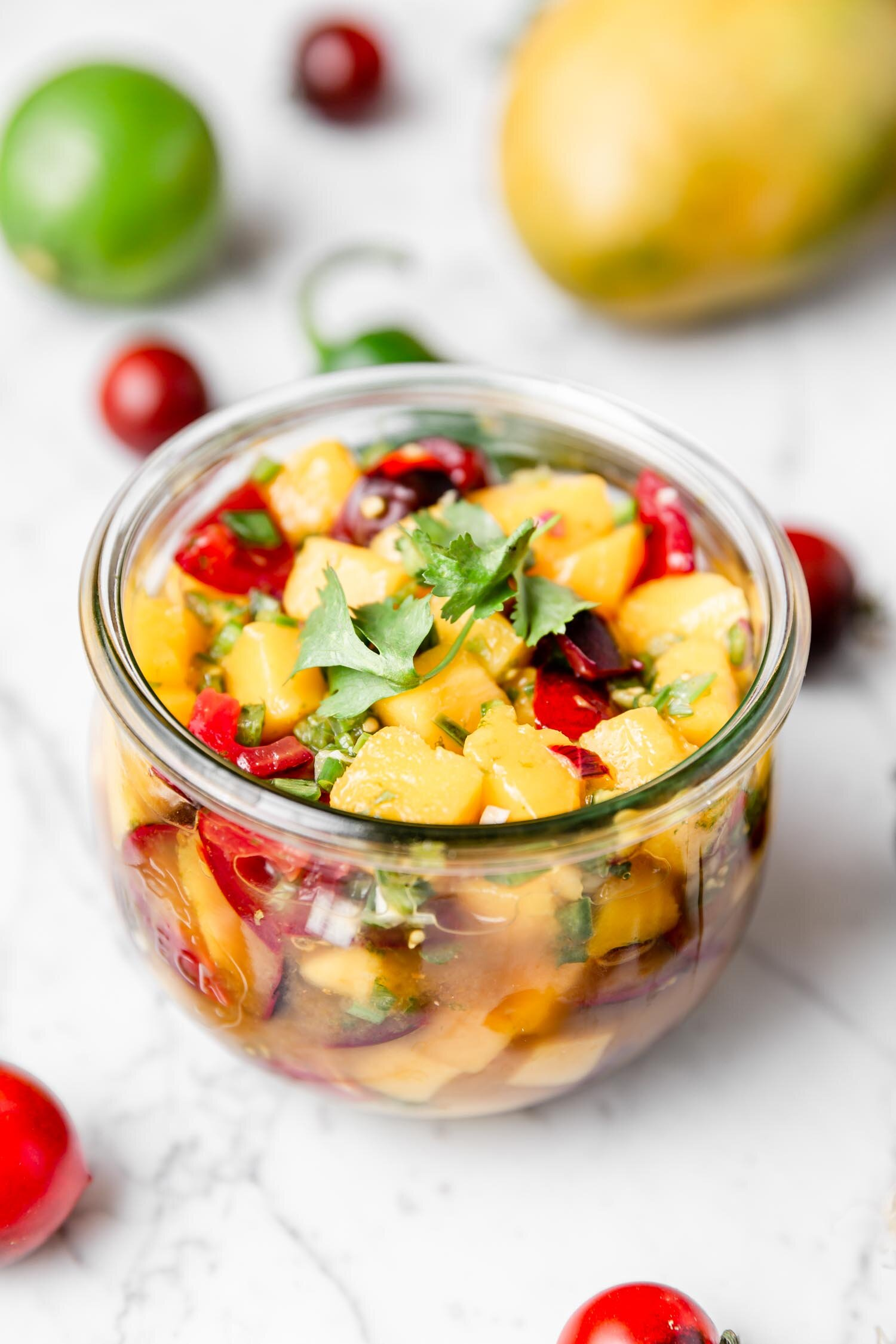 5-ingredient Mango Salsa that is fresh, vibrant, and full of flavor - plus, it's ready in just a few minutes! Sure to disappear quickly, so make a big batch! Recipe by Kari of Beautiful Ingredient.  #mangosalsa #mangorecipe #mangosalsarecipe #vegan #plantbased #salsarecipe #oilfree #glutenfree #suga-free #easyrecipe #quickandeasyrecipes #quickeasymeals #veganmexicanfood