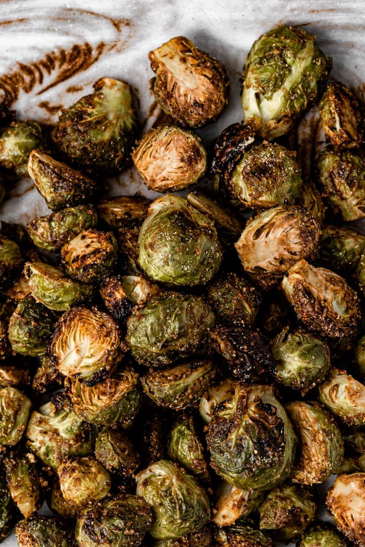 Oil-free Vegan Balsamic Maple Pecan Roasted Brussels Sprouts in the air fryer, with oven option. By Kari of Beautiful Ingredient.  #brusselssprouts #airfryer #brusselssproutsairfryer #brusselssproutsrecipe #vegan #glutenfree #oilfree #recipe #veganrecipe #thanksgiving #christmas #holidayrecipe #fallrecipe #beautifulingredient #roastedvegetables #quickrecipe #crispy