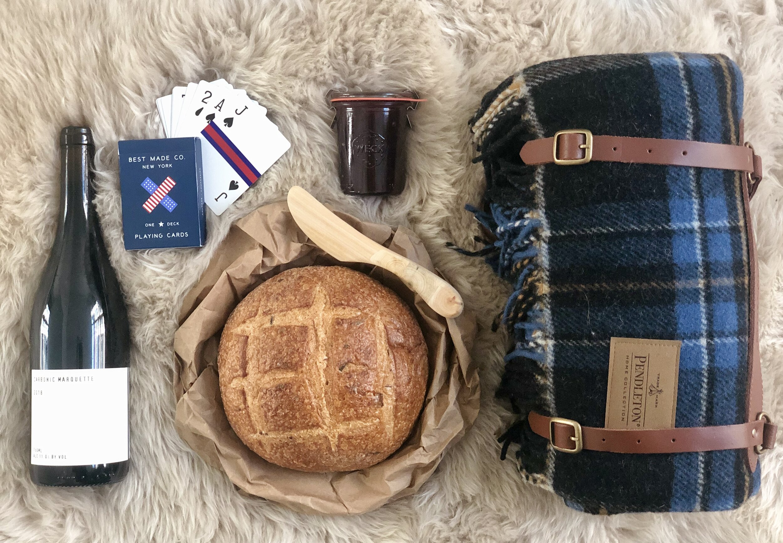 Wild Arc Farm wine  ,   Best Made Co. Playing Cards  ,   Weck Glass Jar   ,    Fittsmile Wooden Spreader  ,   Pendleton Motor Robe With Leather Carrier