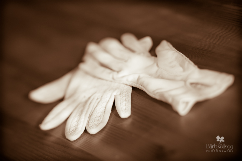 a p air of off white lace gloves