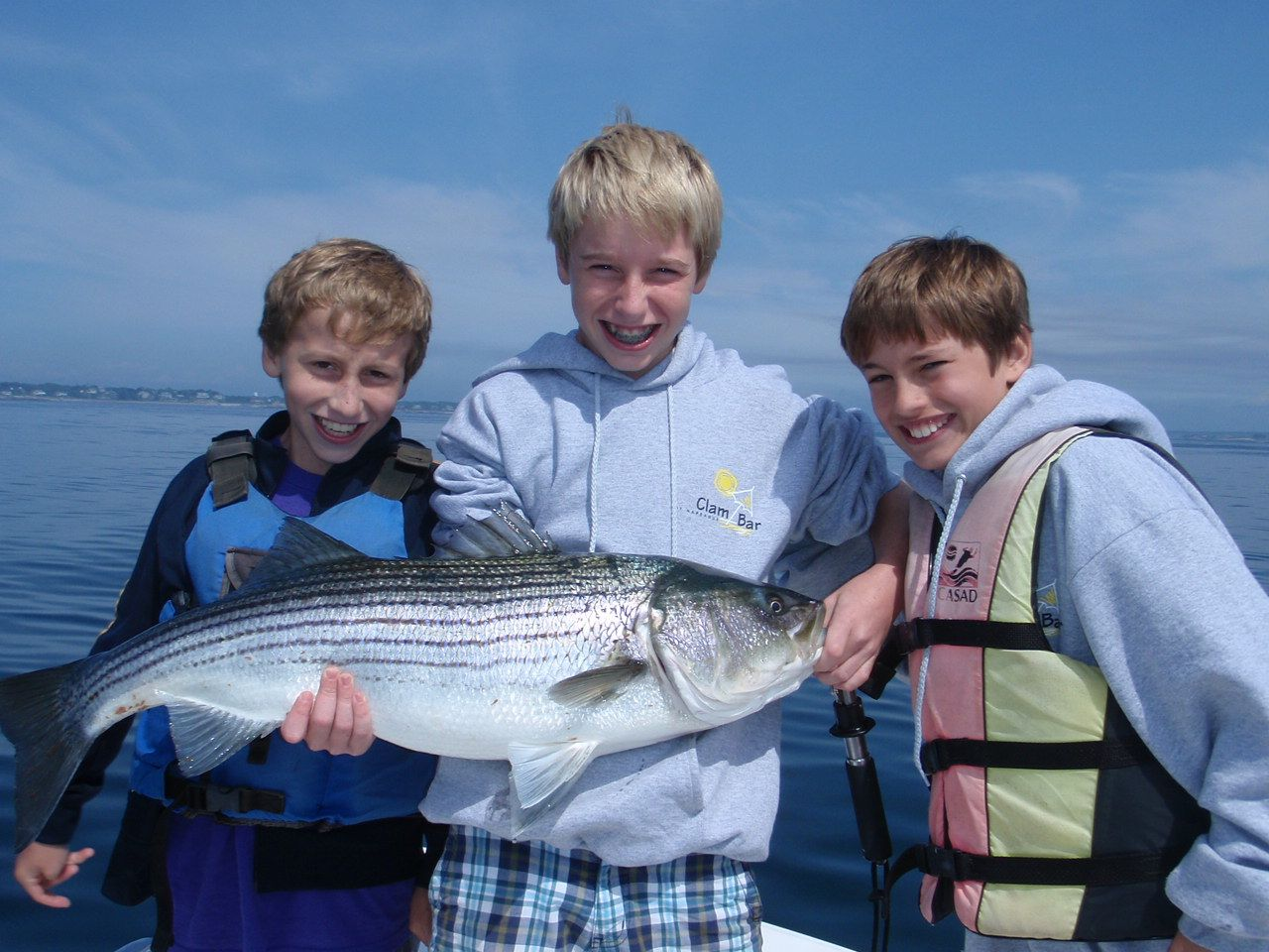 Image of a large striped bass caught in Kids fishing Camp off Marblehead