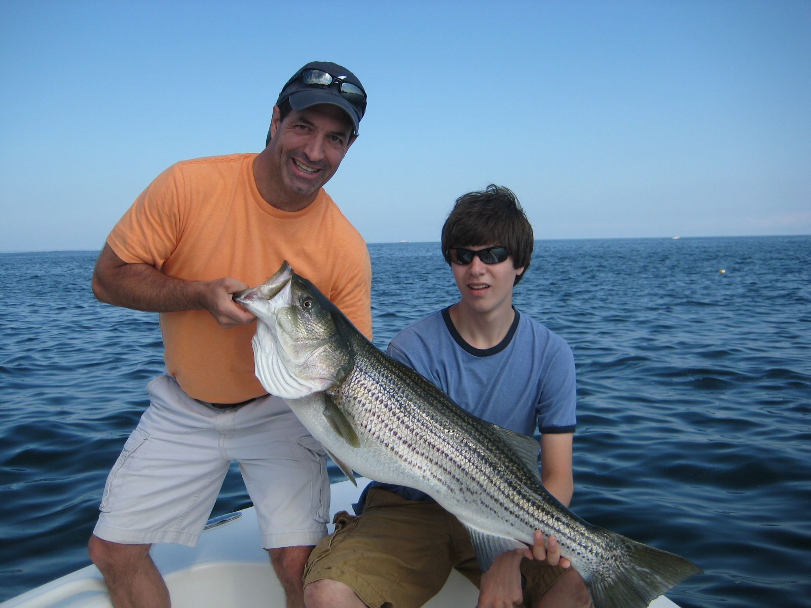 Image of a large striped bass caught by father and son off Boston