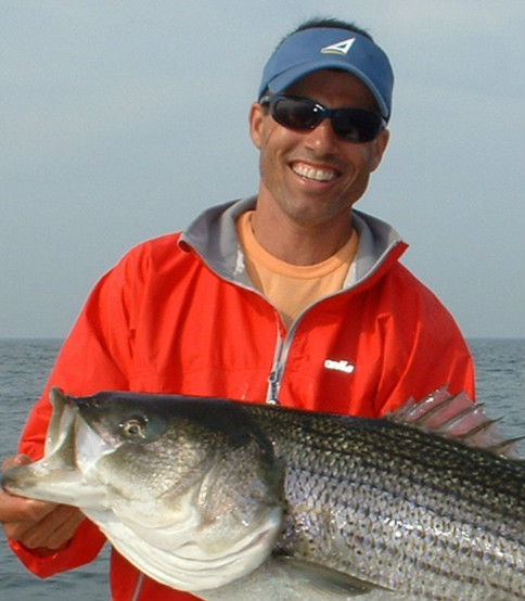 picture of top rated guide Randy Sigler with a nice striped bass released near Marblehead