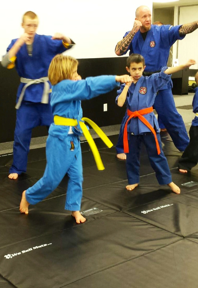 Wojtas orange belt test Katie and Mike.jpg
