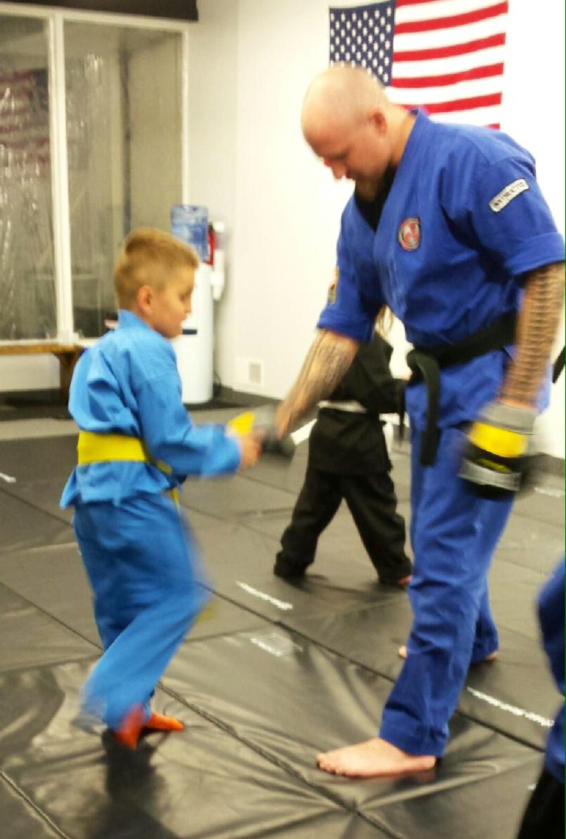 Wojtas orange belt test knees.jpg