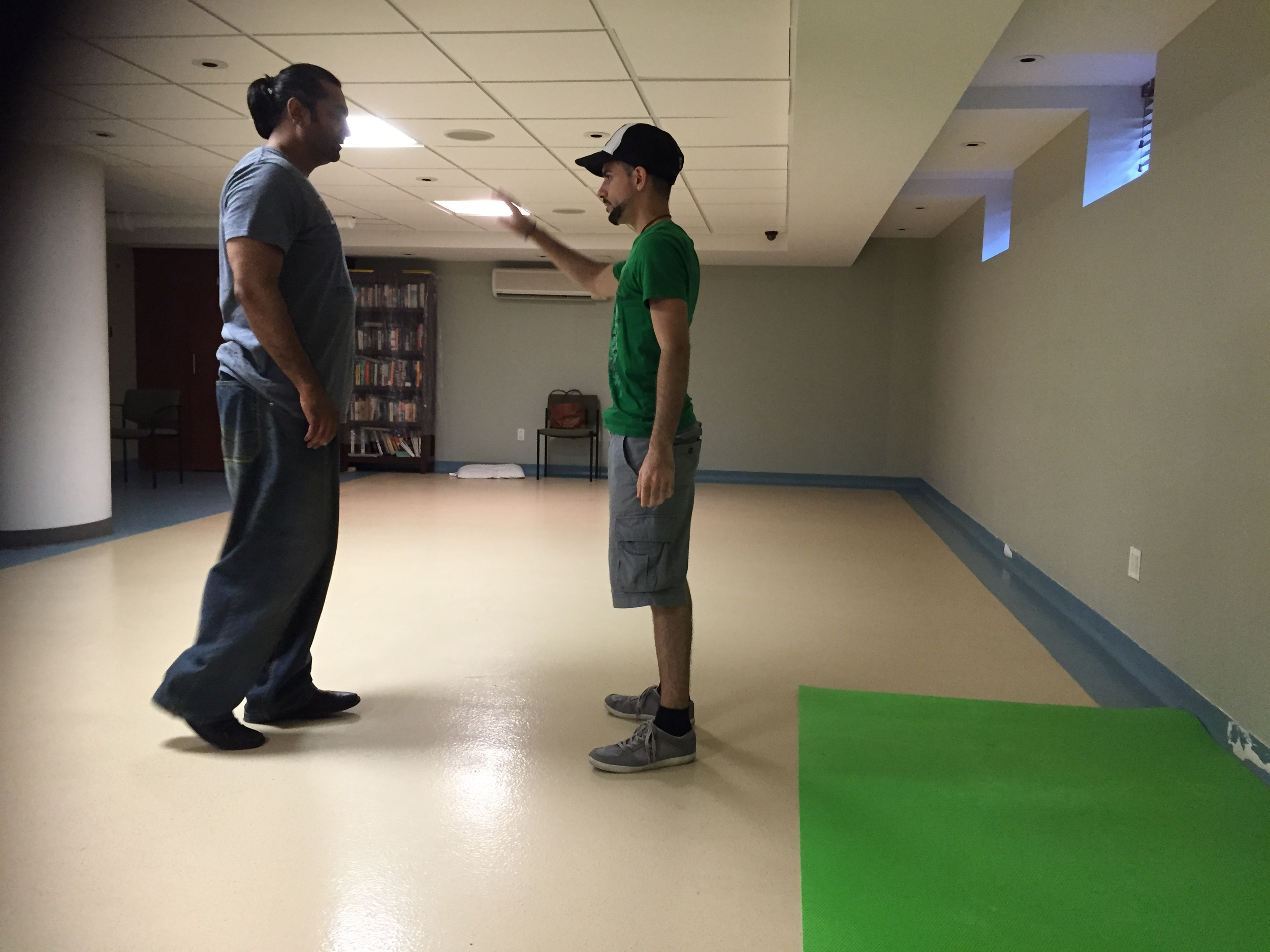 Director Chase Michael Pallante and Stunt Coordinator Alim H. Ali reviewing over structured stunts for the actors to prepare.