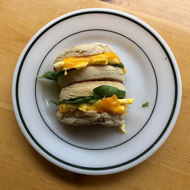 We have breakfast sandwiches! This English muffin, cheddar, egg, and pesto sandwich is sure to satisfy.