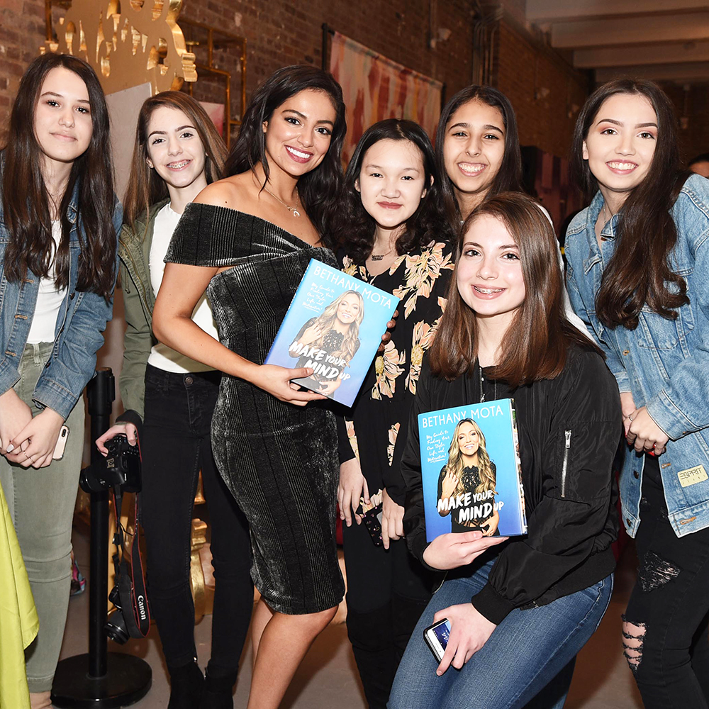 Meeting fans and signing copies of her book, Make Your Mind Up