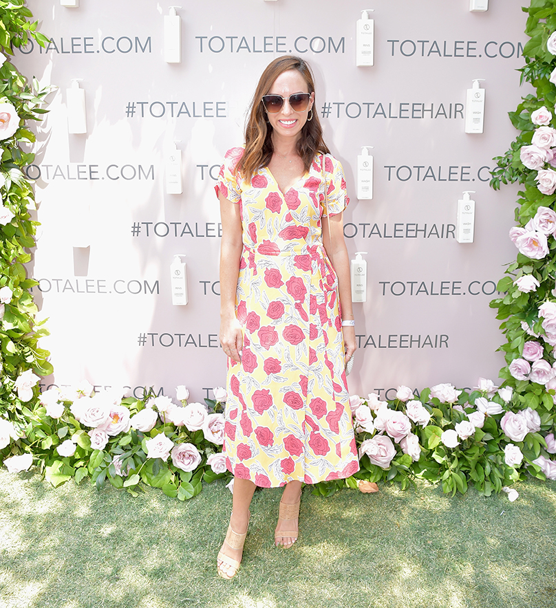 SIMPLY LA moderator Sydne Summer in front of the TOTALEE Selfie Wall