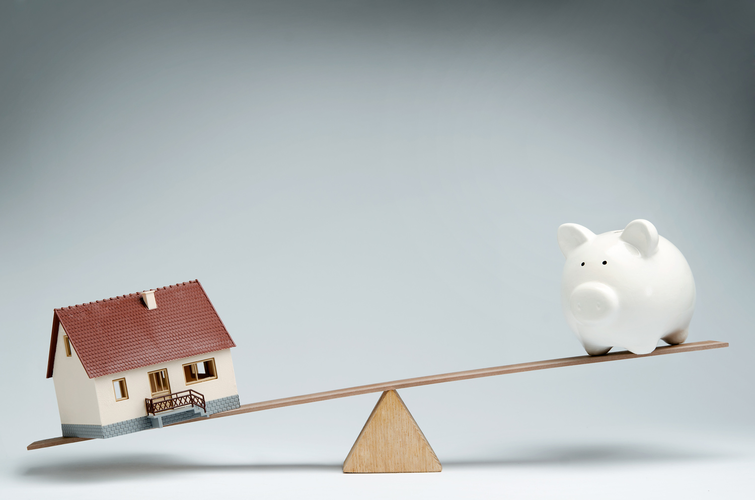 house-piggy-bank-see-saw-abc-debt-solutions.jpg