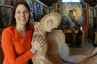 Katherine Quinn poses with one of Anthony Quinn's sculptures