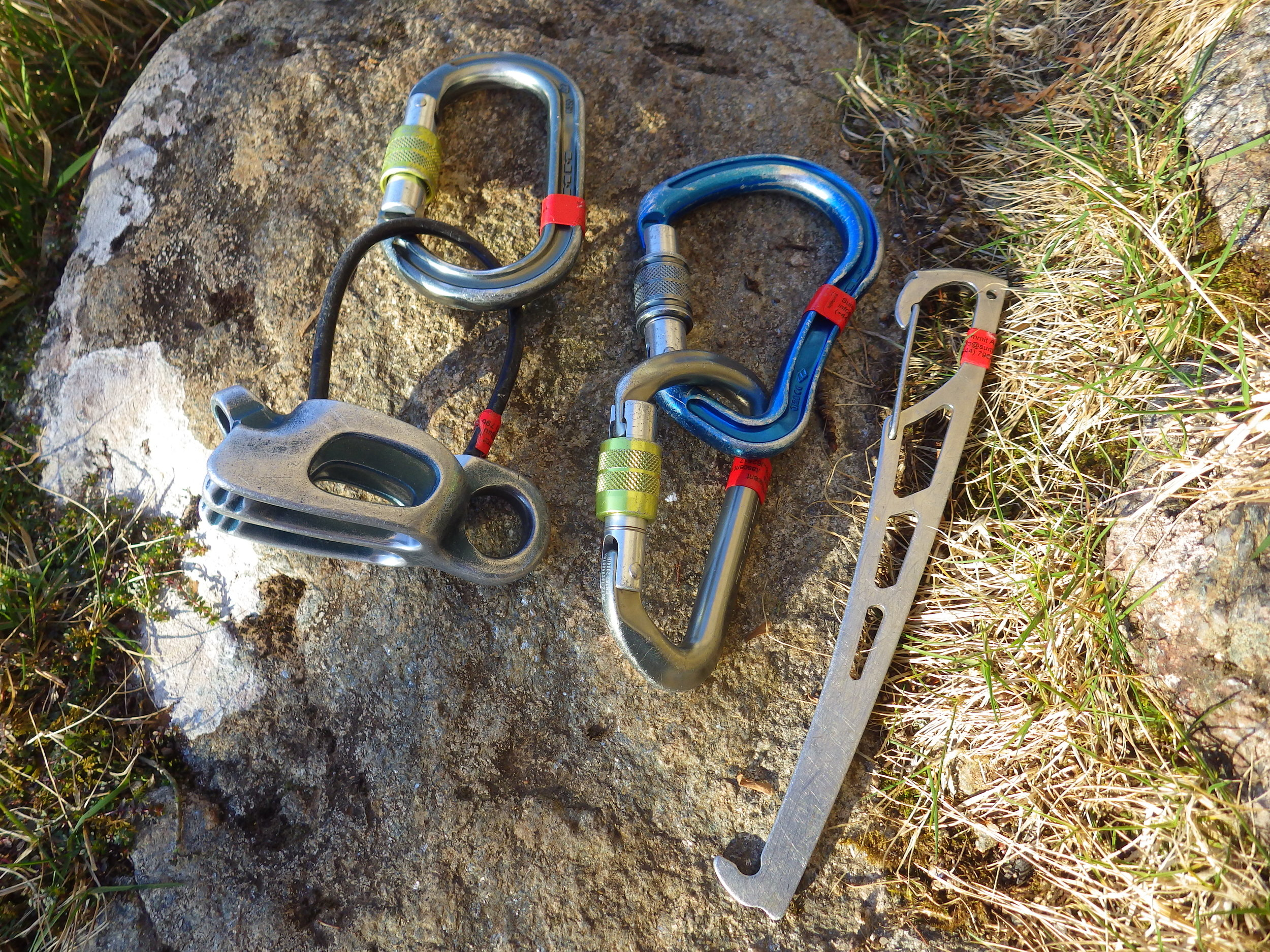 Belay Plate with an Oval carabiner, Blue HMS carabiner and D-Shaped carabiner, and a nutkey