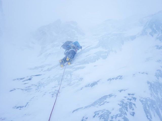 Mandy heading up into the spindrift on 'Salamander Gully'. #scotwinter #winterclimbing @ami_professionals
