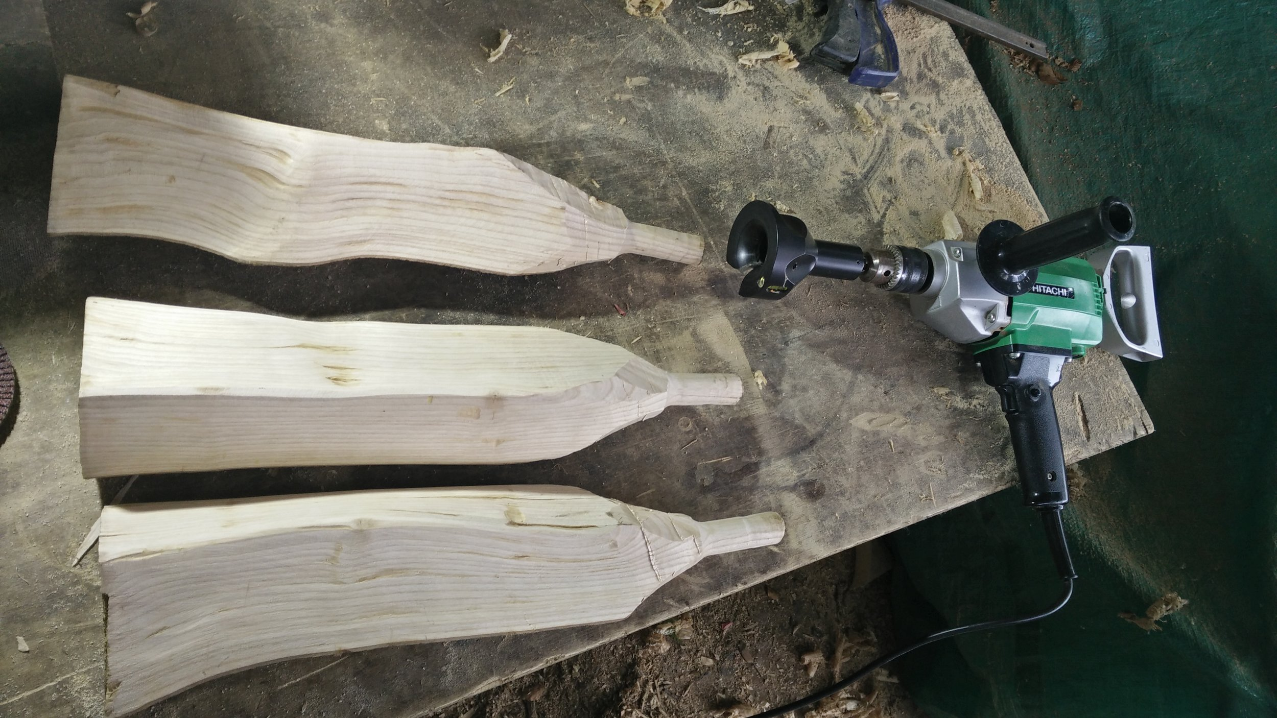 "This step involves splitting and smoothing 3 legs, then drying the legs unless one uses already dry wood for the legs.  The wood must be dry because once the 1"" tennons are cut on the end of them using the electric drill and tenon cutter (a tool like a giant pencil sharpener) there must be no shrinkage which would affect their jointing into the stool top."