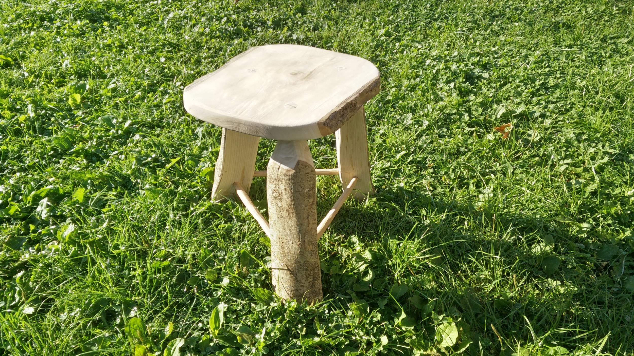 Now as if by magic the stool will appear perfect and finished!  What I didnt show was fitting stretchers and wedging the legs into the stool top. This is quite an involved process and I got so caught up in it I didnt take any photos.  Next time!