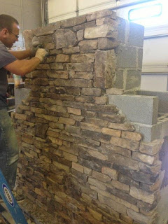 Fireplace Kit being veneered with stacked stone