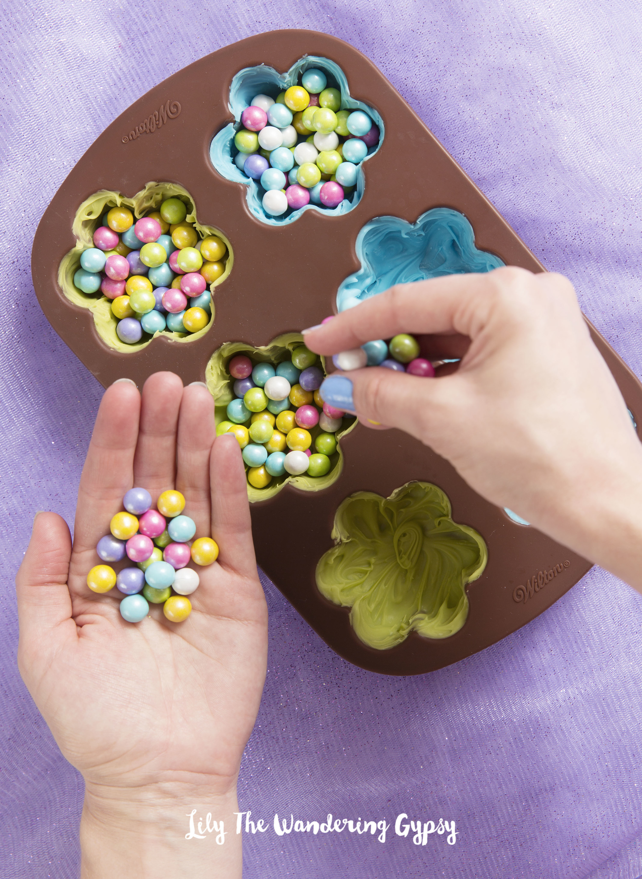 4.) Now, fill the candy shells with Candies, almost to the very top.