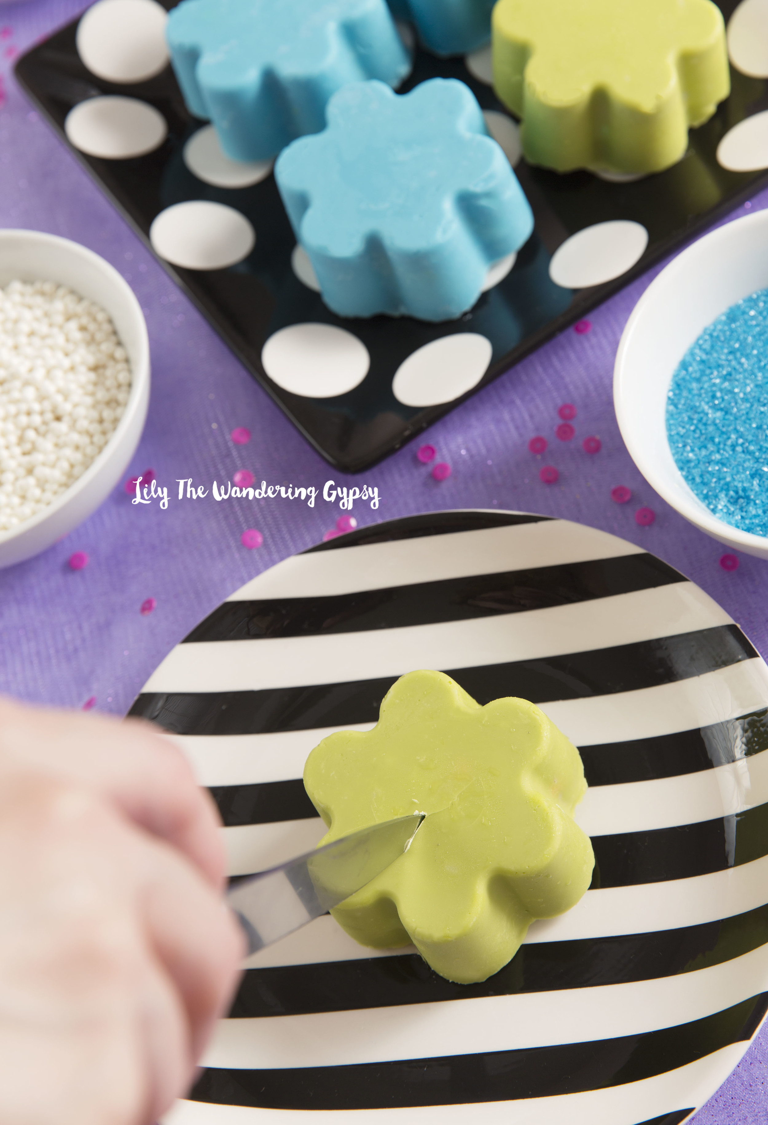 Now you can reveal your surprise candy inside! Just use a sharp kitchen knife, and (very carefully), cut into the candy as if you are cutting a slice of cake.