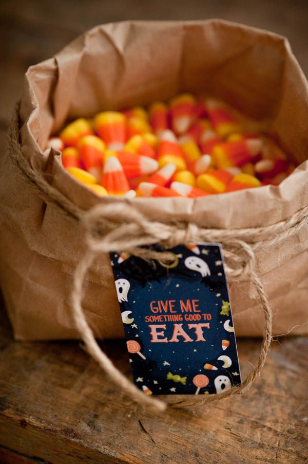 """A rustic  candy corn display  in a paper bag with twine tied around gives this a """"farm"""" feeling"""