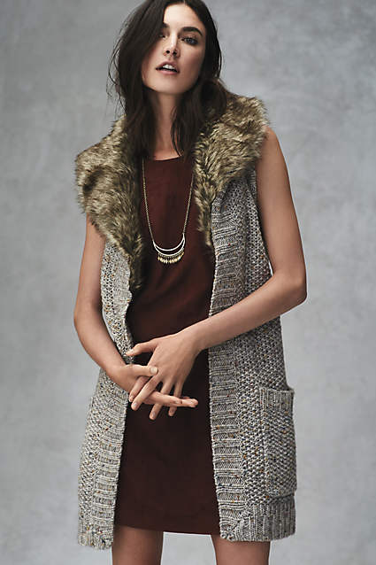 Love this sweater vest with a fuzzy hood!