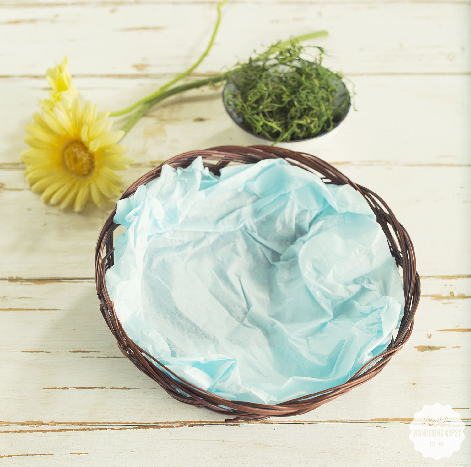 Lightly crumple up a piece of tissue paper and form it to the basket. This will ensure that the moss won't fall out.