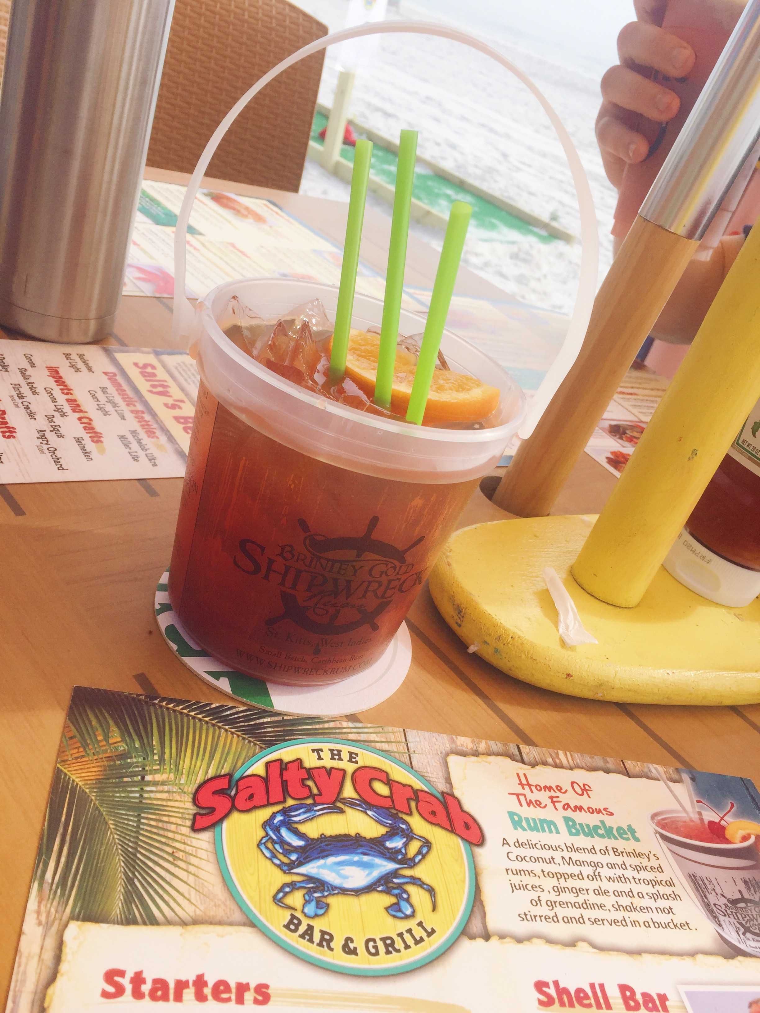 Sitting at The Salty Crab, drinking a Rum Bucket, with my feet in the sand. How fun! The food looked and smelled amazing too.