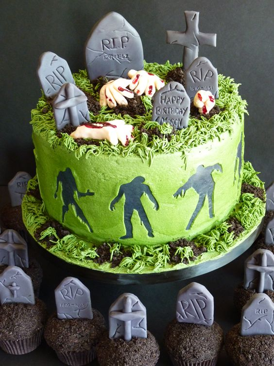 This  zombie cake  looks so realistic and those graveyard cupcakes pair so well with the theme!