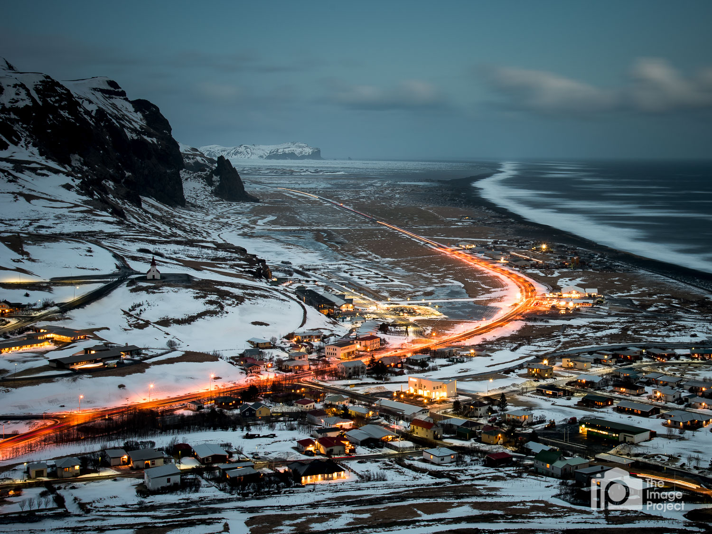 Car light trails as twilight descends on Vik in south Iceland