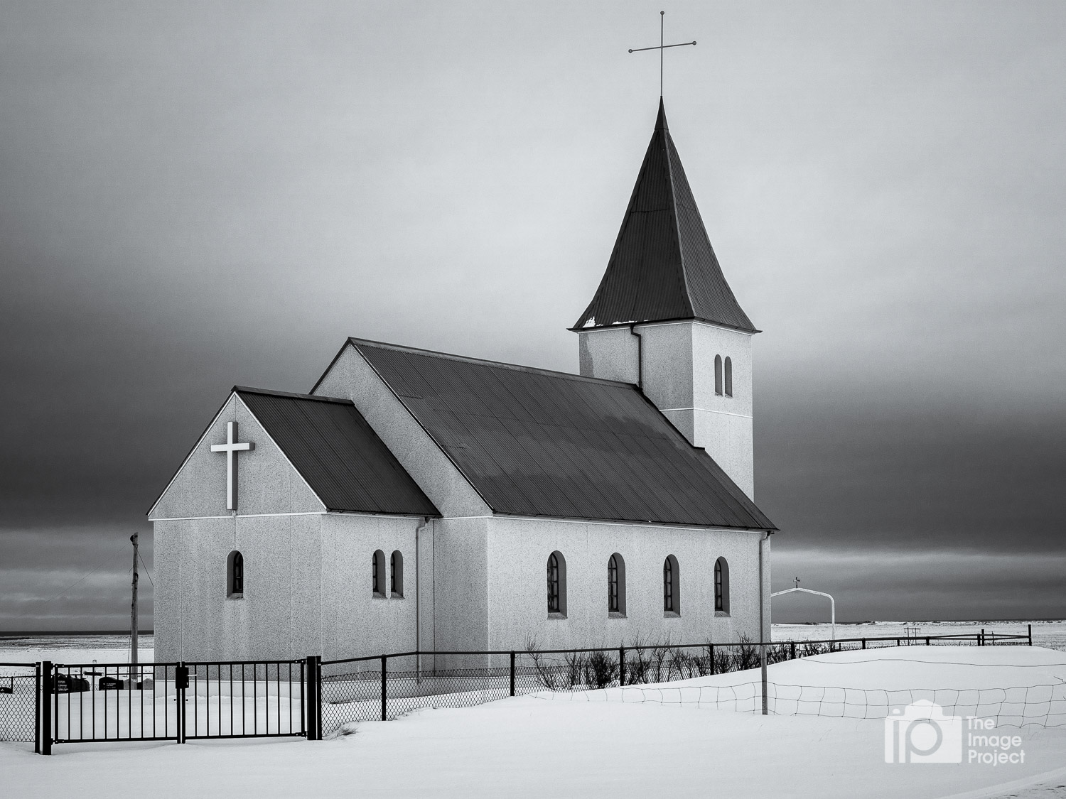 Church in western Iceland looking out across the sea during an overcast day