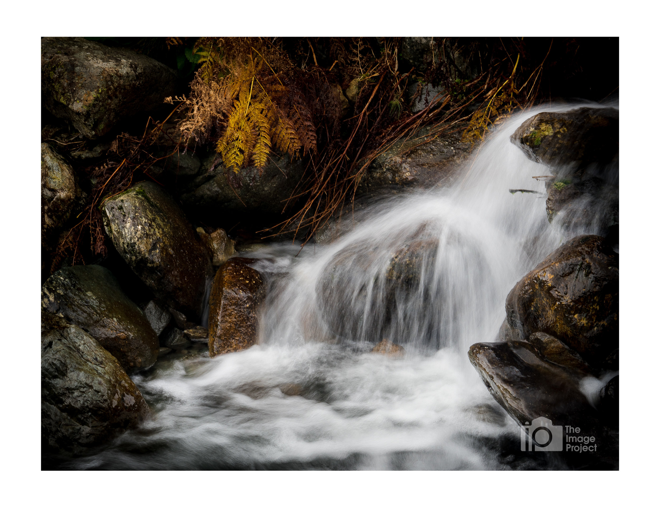 Water cascades into rockpool, near Brotherswater