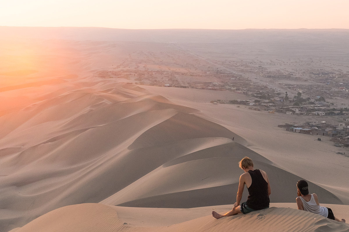 Catch the Last Saharan Sunset of 2018 from the Top of the Dunes - As the sun begins to set in the Moroccan sky, we'll head out as a crew to the top of a Sahara dune to catch the last set of 2018.Optional sandboarding and camel rides included!